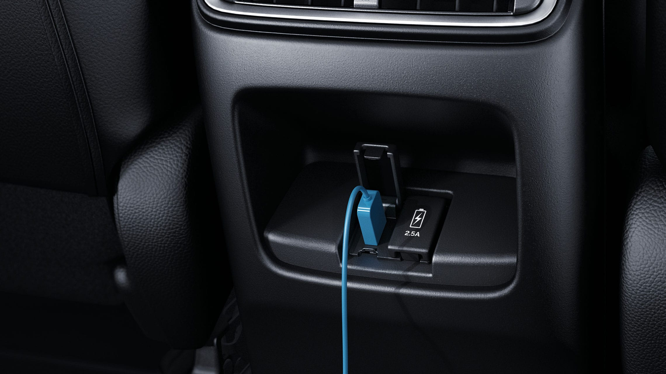 Interior view of rear USB ports in the 2021 Honda CR-V.