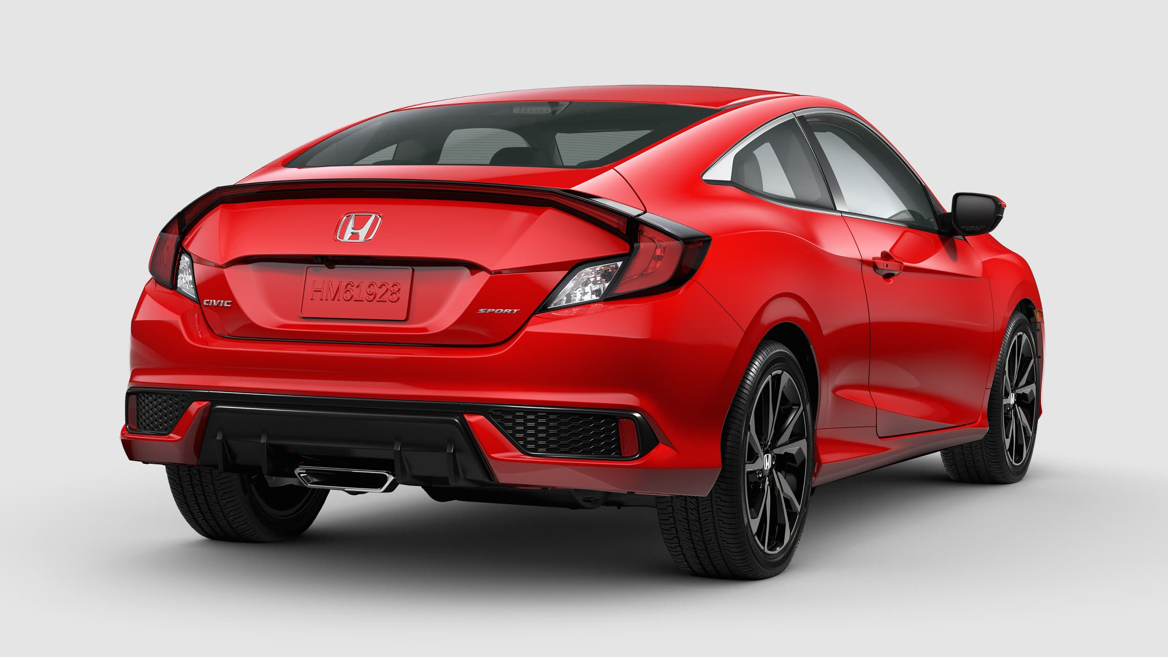Rear view of the 2020 Honda Civic Sport Coupe in Rallye Red.