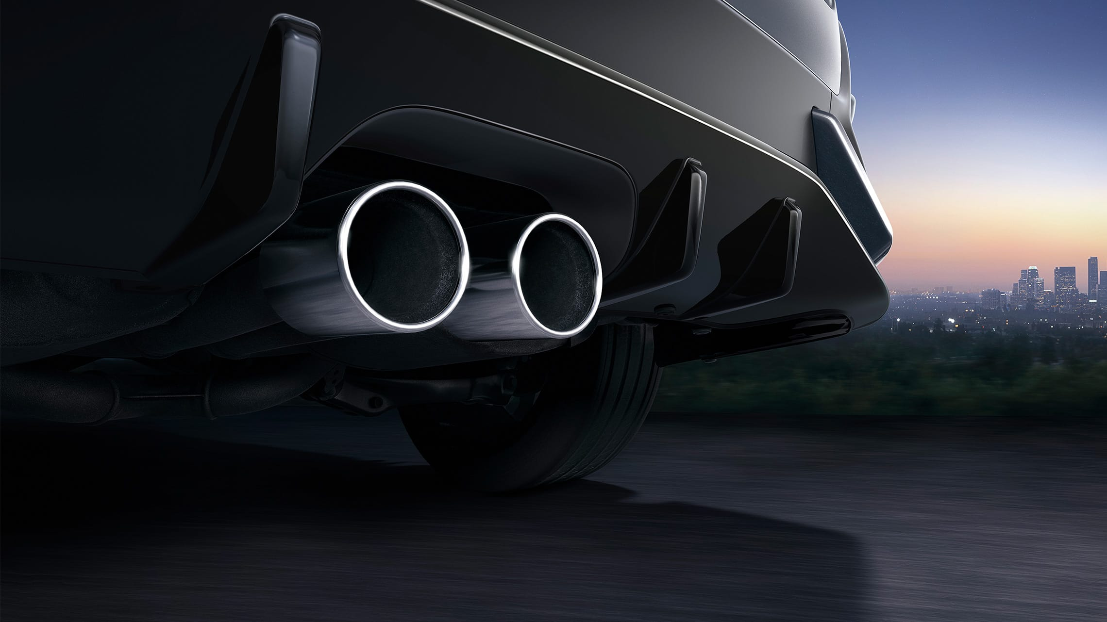 Salida de escape doble central en el Honda Civic Sport Touring Hatchback2021 en Sonic Gray Pearl.
