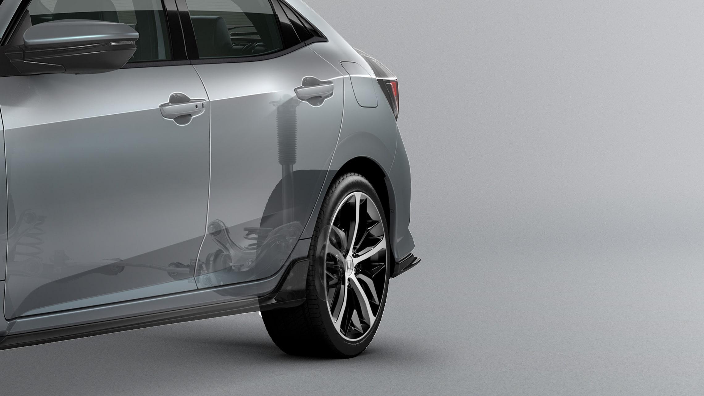 Ilustración de la suspensión trasera independiente del Honda Civic Sport Touring Hatchback2021 en Sonic Gray Pearl.