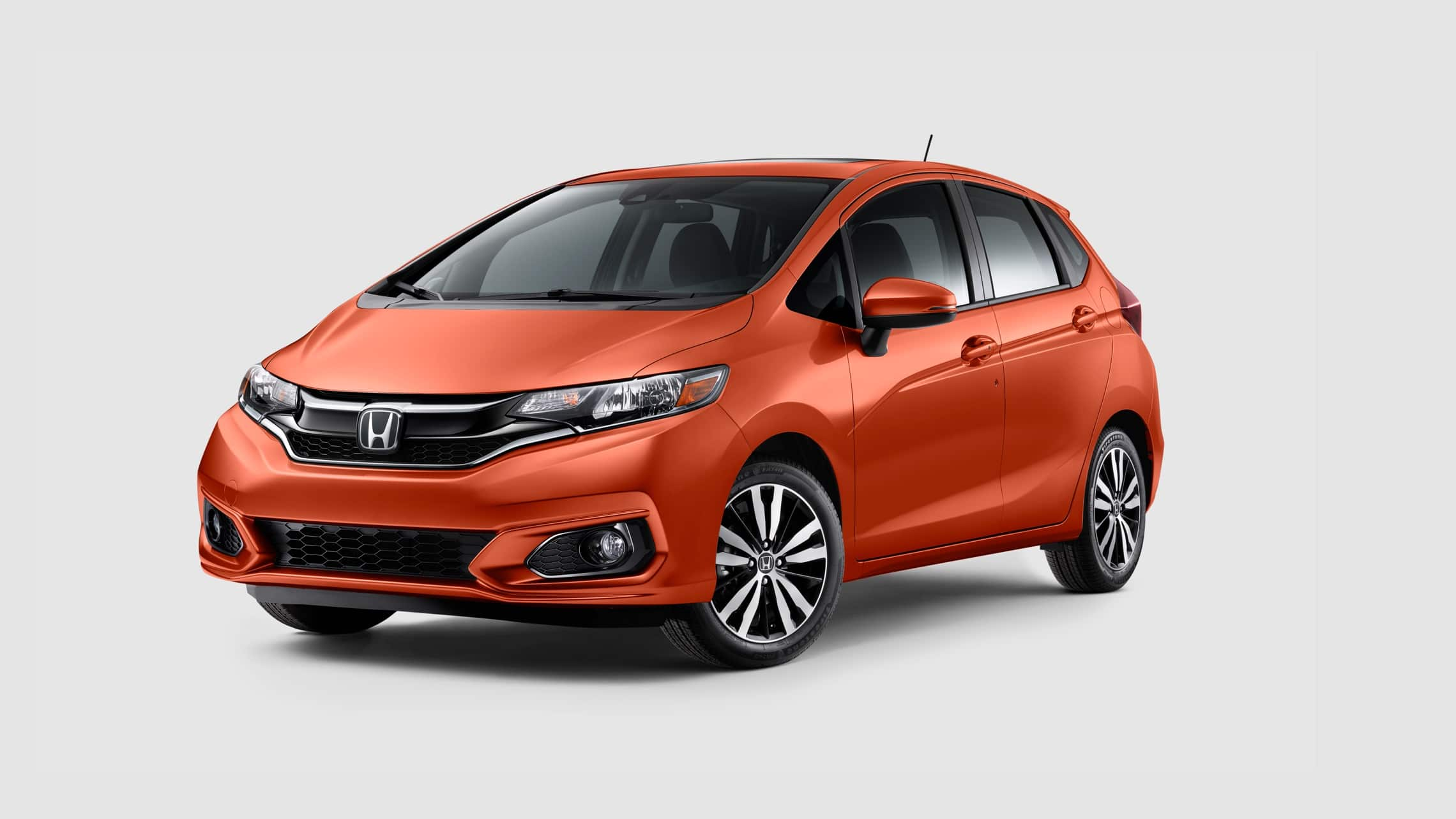 Front driver-side view of the 2020 Honda Fit EX-L in Orange Fury.