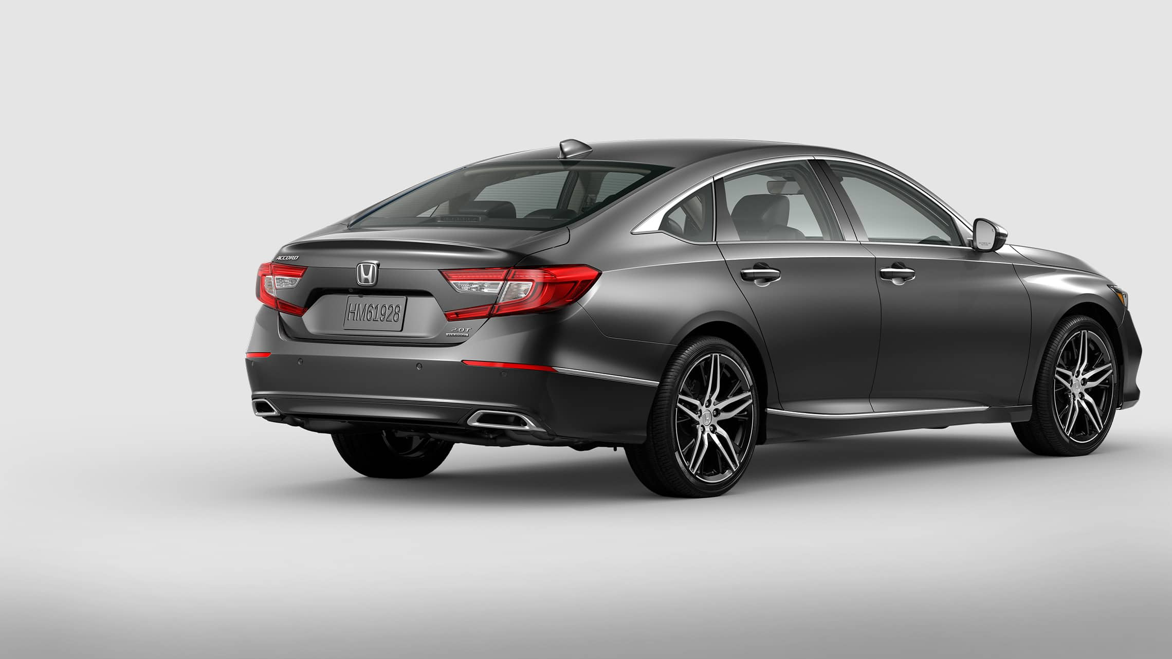 Rear passenger-side view of 2021 Honda Accord Touring 2.0T in Modern Steel Metallic.