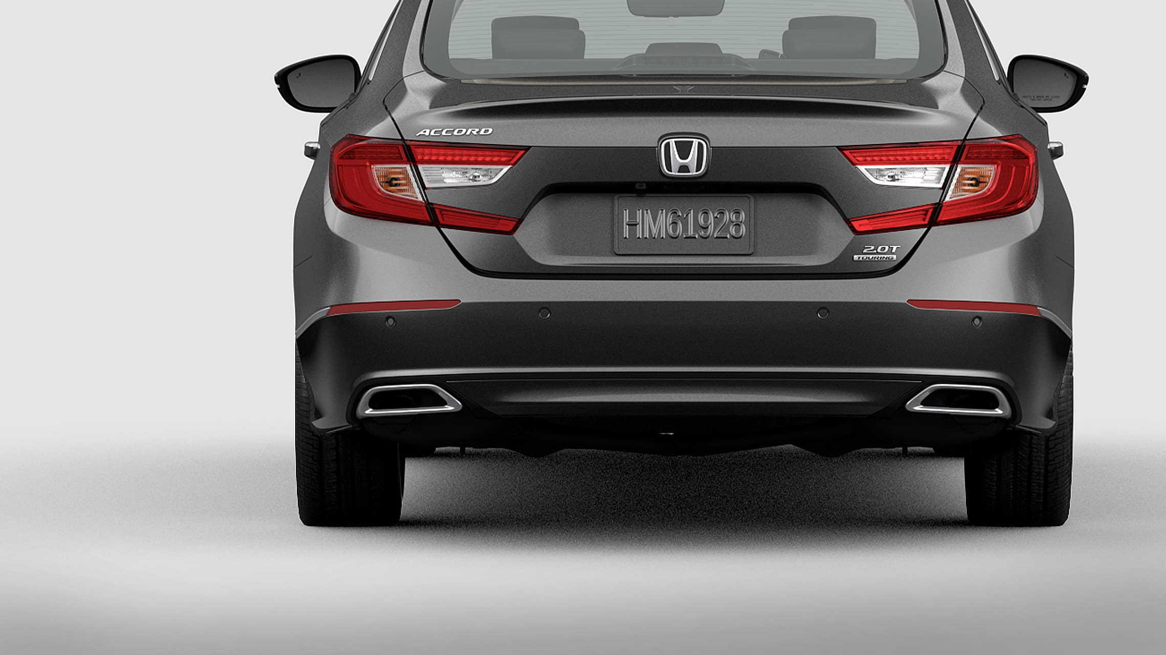 Taillights with integrated LED light bars and parking sensors detail on the 2021 Honda Accord Touring 2.0T in Modern Steel Metallic.