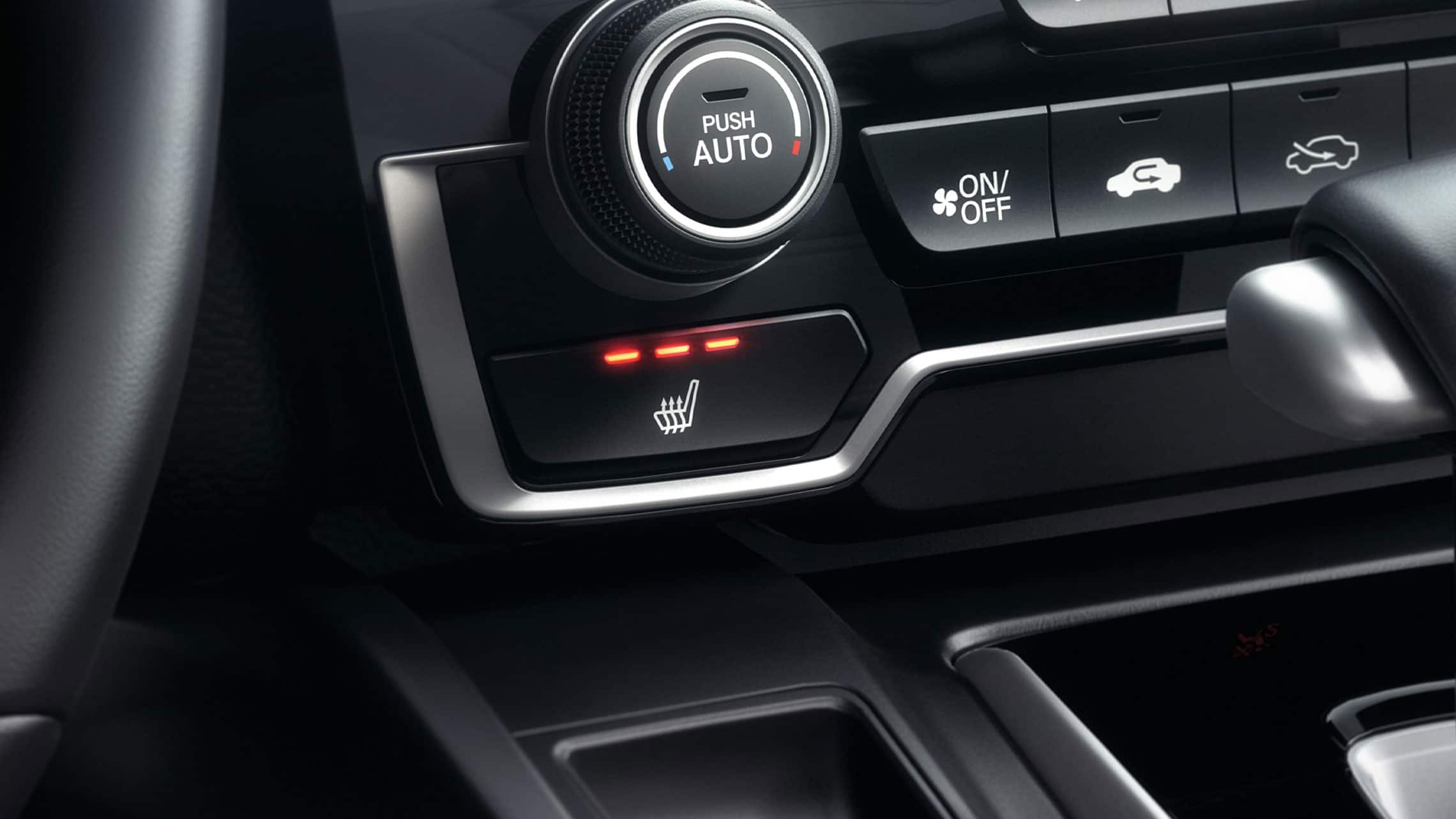 Heated front seat controls detail in the 2021 Honda CR-V with Black Leather.