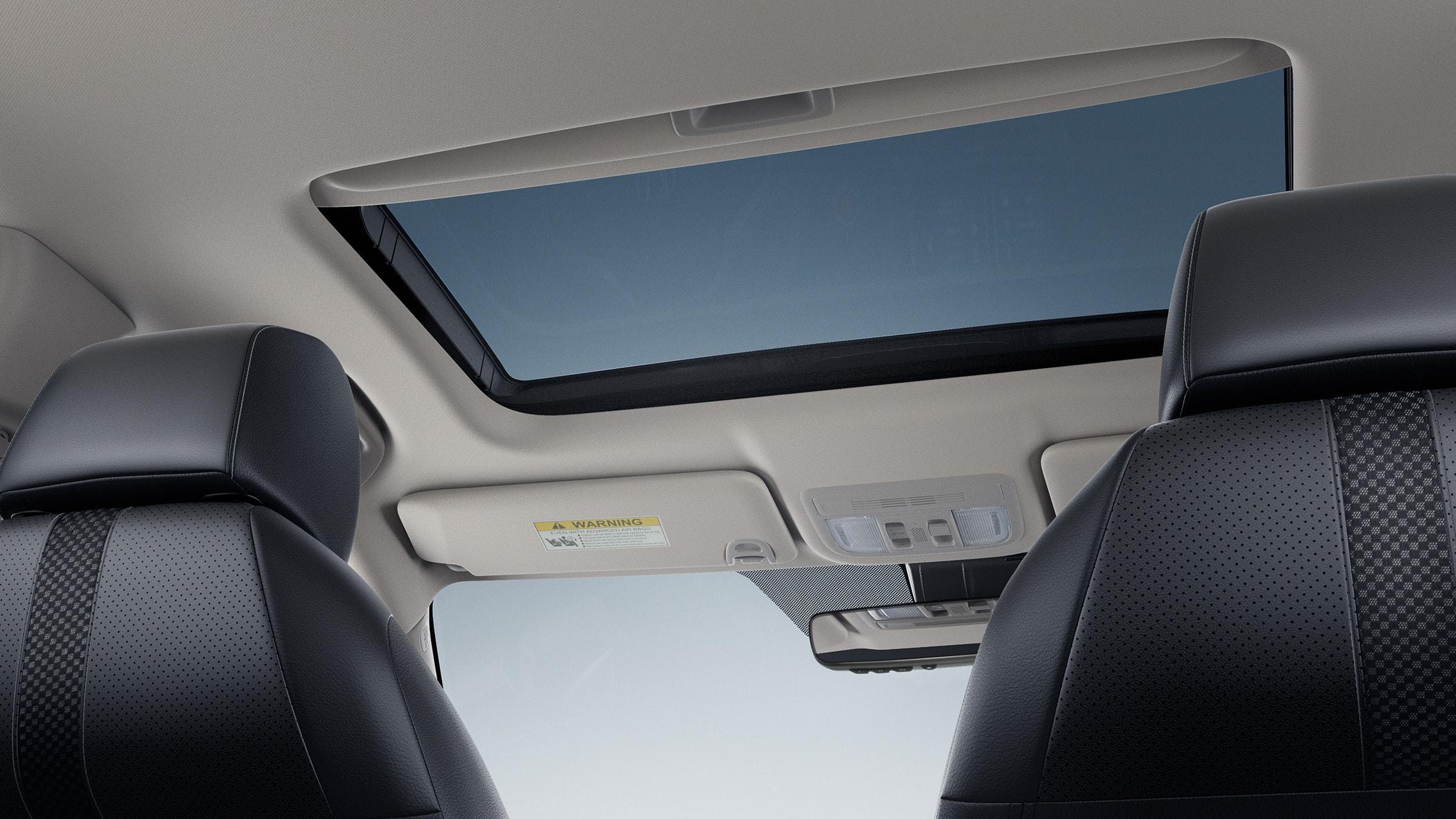 Detalle de la activación del techo corredizo con un toque en el Honda Civic Touring Sedán2021.