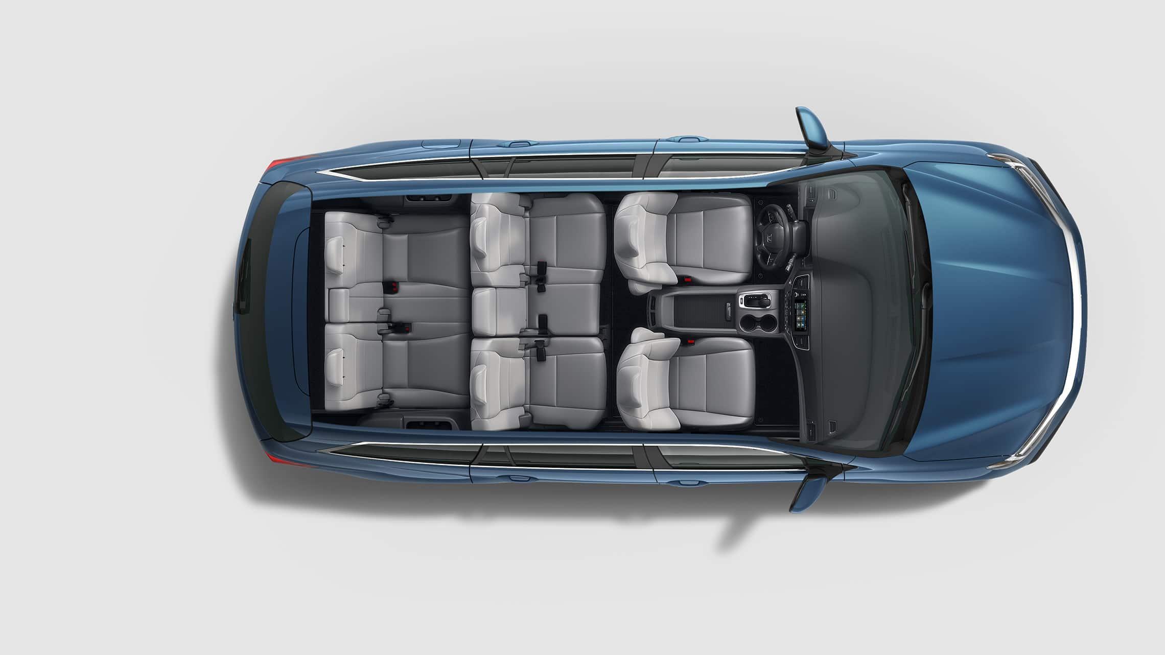 Vista aérea de la Honda Pilot Elite2021 en Steel Sapphire Metallic con configuraciones de asientos.